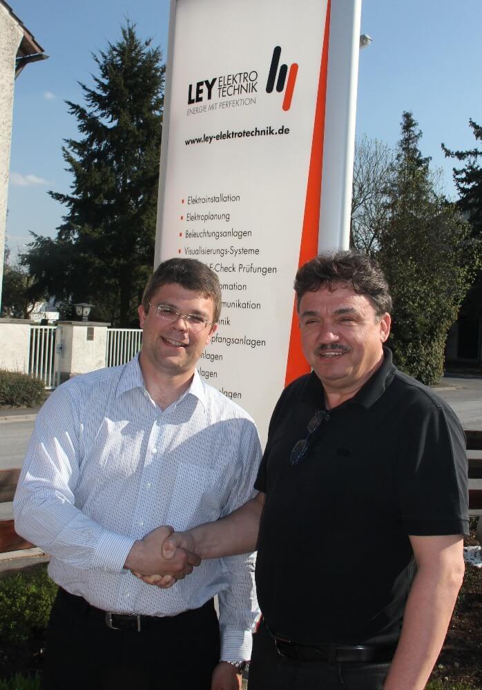 Herr Ley (v. r.) und Herr Schröder
